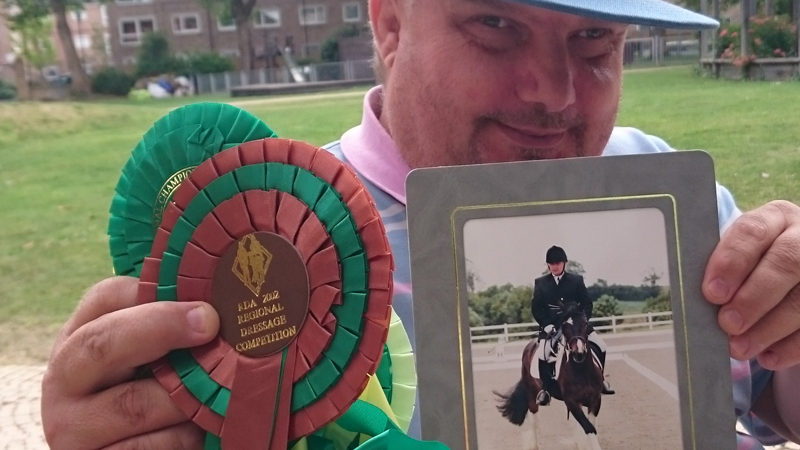 Francis with his riding rosettes from RIding for the Disabled